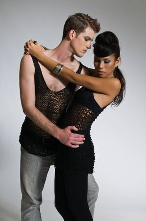 Beautiful young couple dressed in black mesh