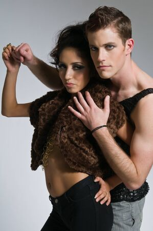 Beautiful young couple dressed in black mesh photo