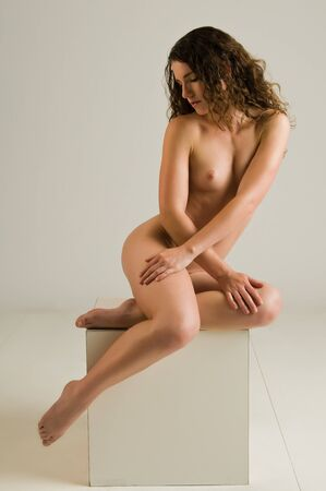 Pretty young nude brunette against gray Stock Photo - 8805270