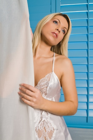 Beautiful young Czech woman in white lingerie Imagens