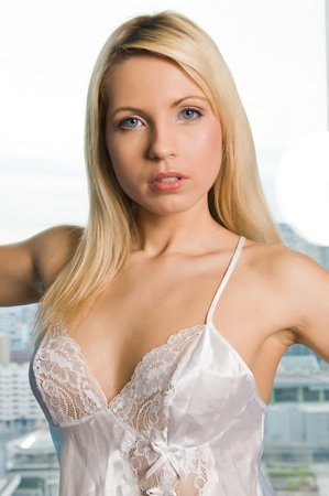 negligee: Beautiful young Czech woman in white lingerie Stock Photo