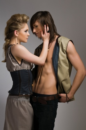 Beautiful tall couple in stylish vests and pants Stock Photo - 9064229