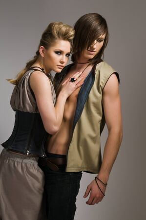 long hair boy: Beautiful tall couple in stylish vests and pants