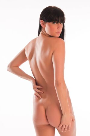 undressed young: Pretty slender long haired nude brunette on white Stock Photo