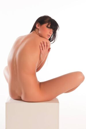 undressed young: Pretty young brunette nude over white
