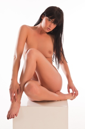 Pretty young long haired brunette nude over white Stock Photo - 9373617