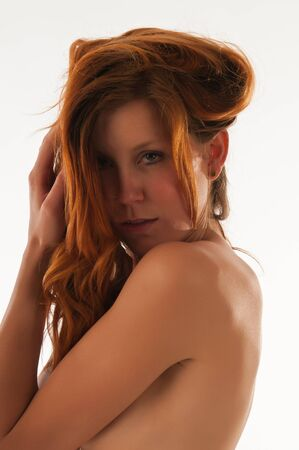 Beautiful tall slender redhead nude over white Stock Photo - 9553263