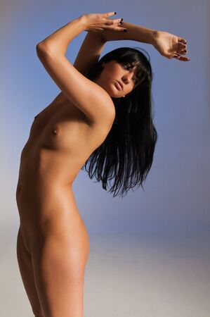 Beautiful tall young brunette nude over blue Stock Photo - 9642798