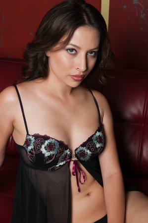 Pretty young latina dressed in black lingerie photo