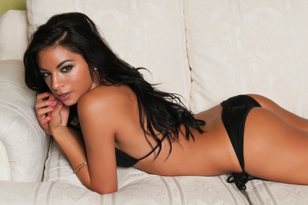 petite: Pretty young Latina in a black bikini