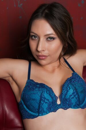 blue lingerie: Pretty young latina dressed in blue lingerie