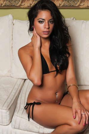 Pretty young Latina in a black bikini photo