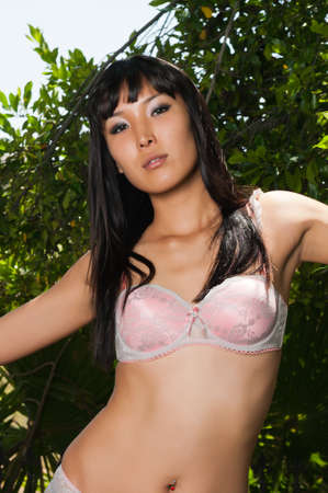 mongolian: Tall young Mongolian woman outdoors in pink lingerie