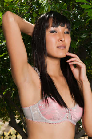 Tall young Mongolian woman outdoors in pink lingerie Stock Photo - 9711831