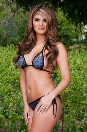 sexy bikini girl: Beautiful young Latina in a black and violet bikini Stock Photo