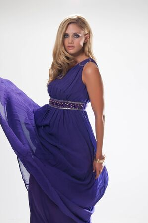 Beautiful tall blonde in the costume of a Greek goddess photo