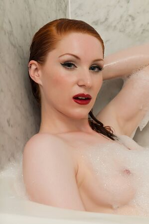 Lovely pale redhead in a bubble bath Stock Photo - 9878450