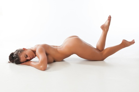undressed young: Athletic nude brunette demonstrating gymnastic skills