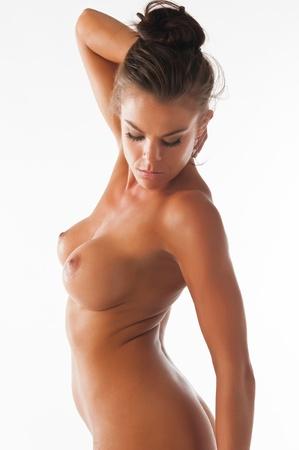 femme se deshabille: Athl�tique brunette nue, d�montrant les comp�tences gymnastique