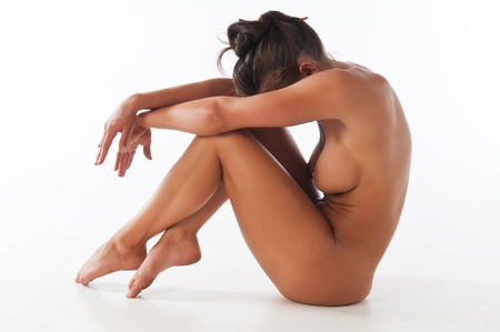 nudity young: Athletic nude brunette demonstrating gymnastic skills