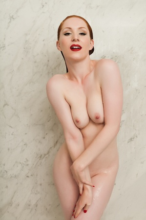 Lovely pale redhead in the shower