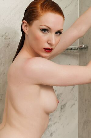 Lovely pale redhead in the shower Stock Photo - 10002523