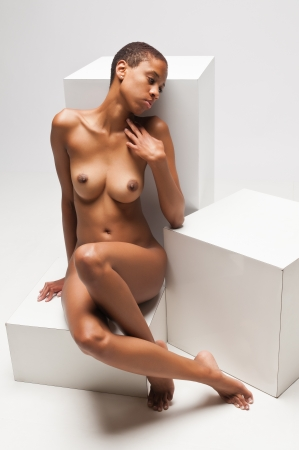 Slender young black woman posing nude