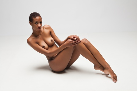 Slender young black woman posing nude on white Stock Photo - 10002234