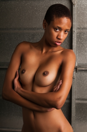 topless brunette: Slender young black woman posing nude