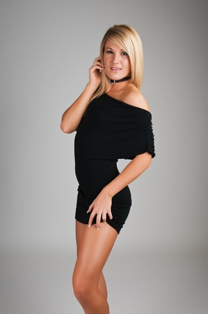 Lovely young blonde in a little black dress photo