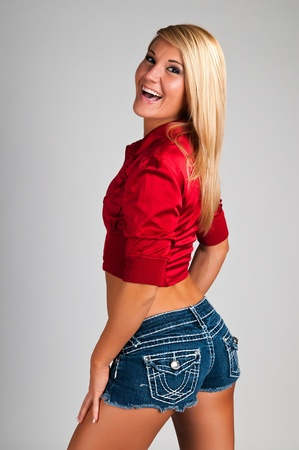 sexy cowgirl: Lovely young blonde in a sexy cowgirl outfit