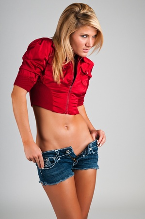 Lovely young blonde in a sexy cowgirl outfit photo