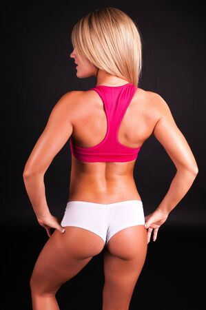 booty shorts: Lovely young blonde dressed for her workout Stock Photo