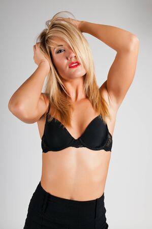 Lovely young blonde in a black bra Stock Photo - 10002041
