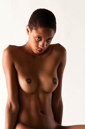topless brunette: Slender young black woman posing nude on white