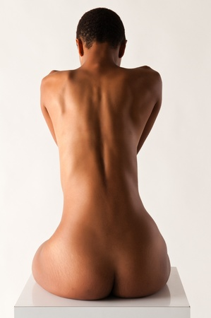 african american nude: Slender young black woman posing nude on white