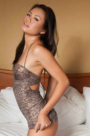 Pretty young Singaporean woman in a tight dress Stock Photo - 10001772