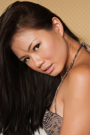 Closeup on the face of a pretty young Singaporean woman photo
