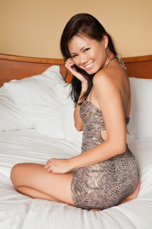 tight dress: Pretty young Singaporean woman in a tight dress