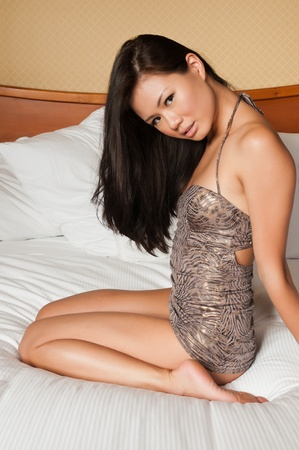 singaporean: Pretty young Singaporean woman in a tight dress