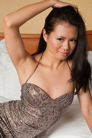 Pretty young Singaporean woman in a tight dress photo