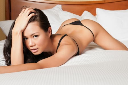 thongs: Pretty young Singaporean woman in skimpy lingerie