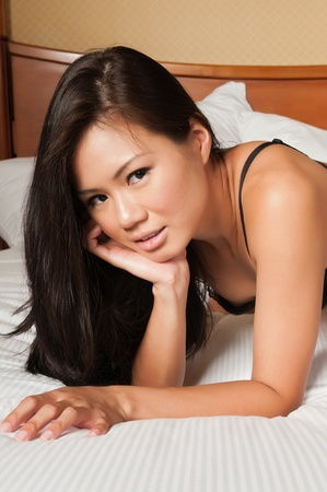Pretty young Singaporean woman in skimpy lingerie Stock Photo - 10001848