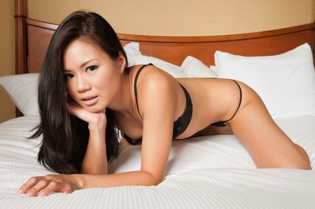 Pretty young Singaporean woman in skimpy lingerie photo