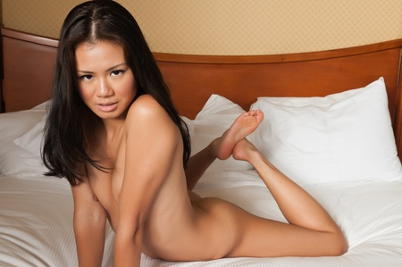 asia nude: Pretty Singaporean woman lying nude in bed