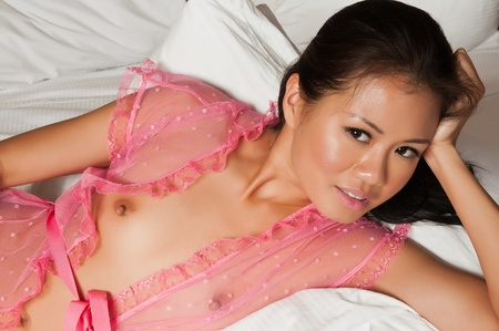 asia nude: Pretty Singaporean woman in a transparent pink wrap