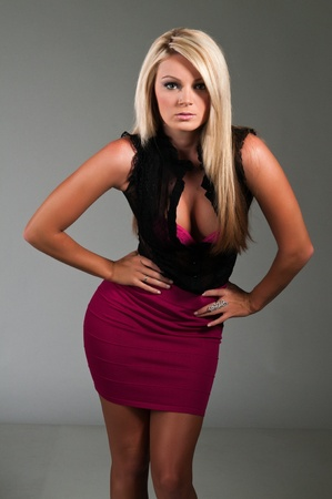 Beautiful curvy blonde dressed in black and purple Stock fotó - 10001539