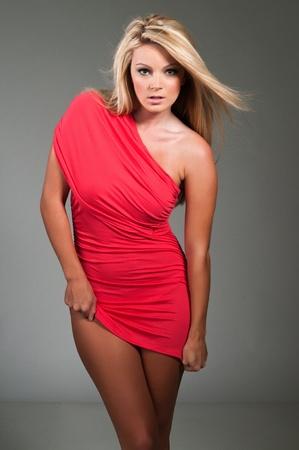 tight dress: Beautiful curvy blonde dressed in a tight red dress