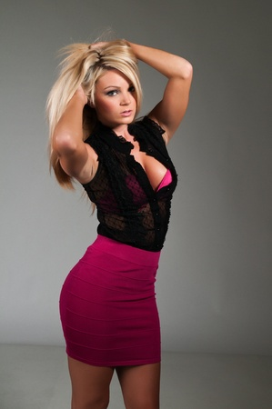 Beautiful curvy blonde dressed in black and purple