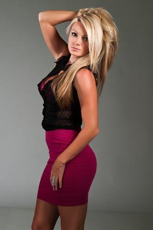 Beautiful curvy blonde dressed in black and purple